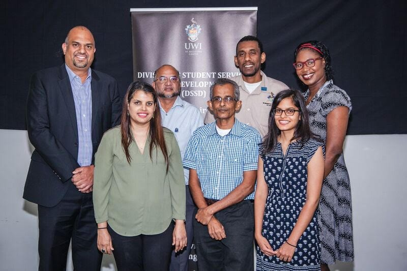 IAC Director – Anand Pascal; Chandar Gupta Supersad – Manager, Financial Advisory Services; Ian Moreno – Office Attendant; Karen Edwards-Sheppard - Administrative Assistant – Scholarships and Bursaries; Aarti's parents and Aarti Lutchme Singh